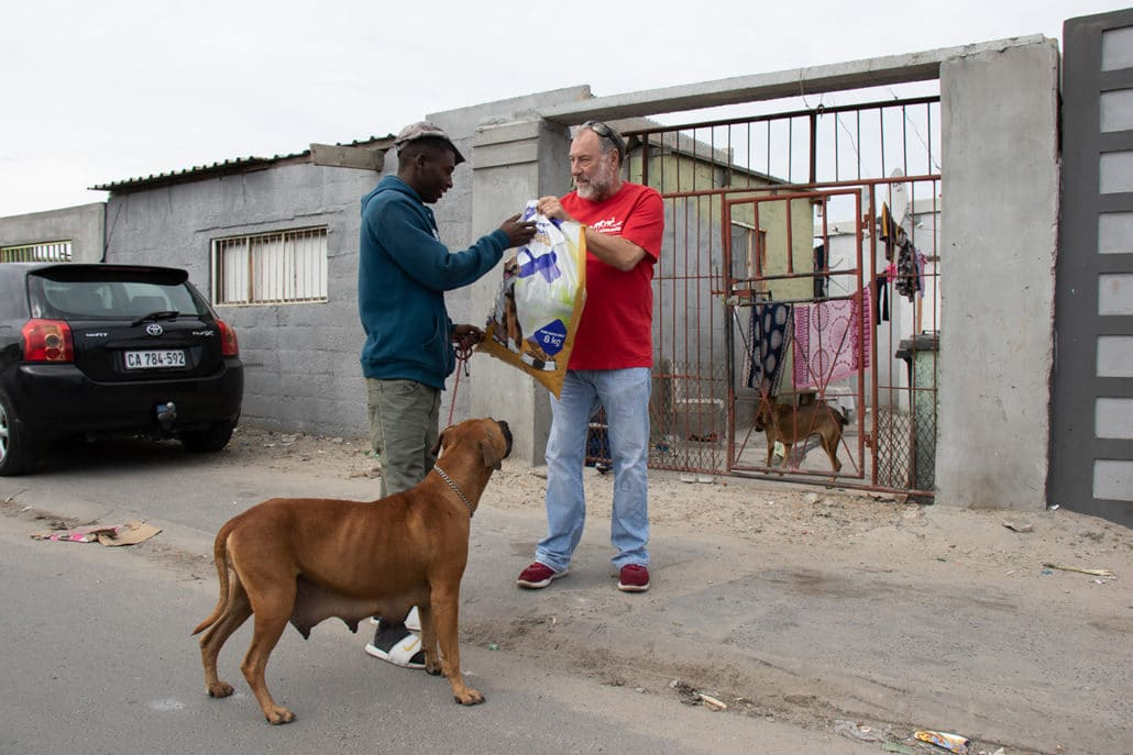 With armed guards and a police escort, we entered the crime-ridden zone to help dogs and cats… 4